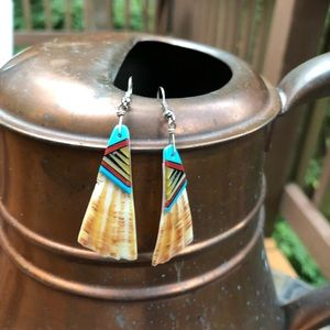 Southwestern style inlaid shell earrings.